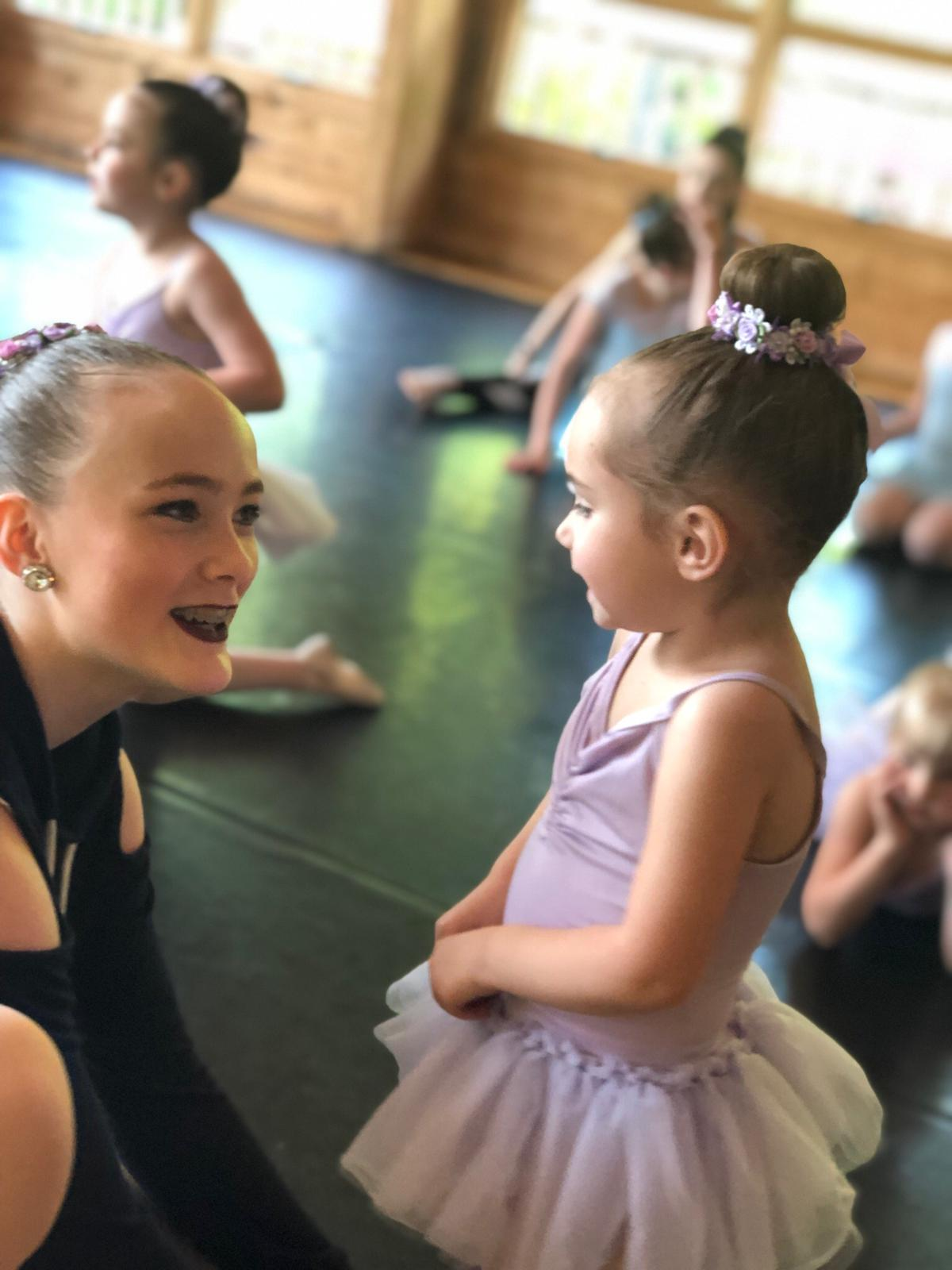 young ballet dancer talking to mentor